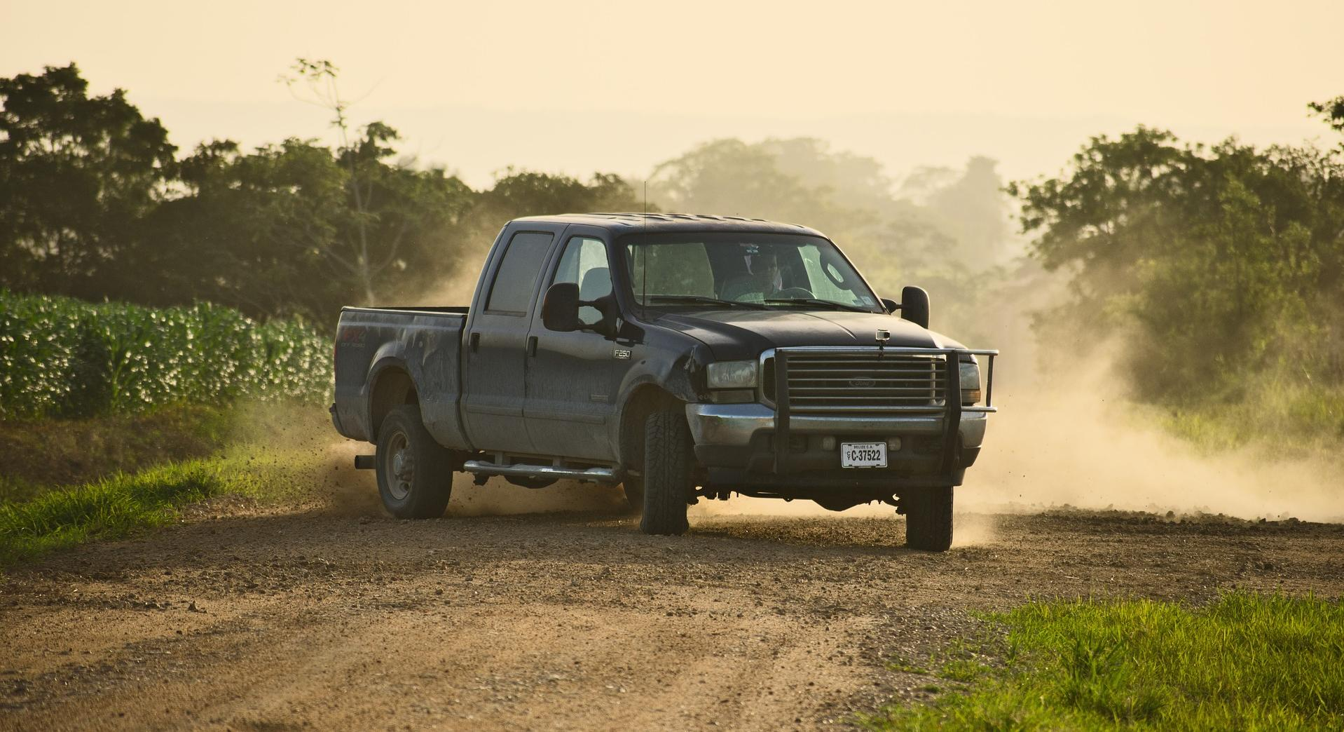 pickup truck on dirt road